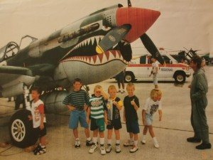 Wes Alberts (in green), with the P-51 Mustang that helped spark his interest in flying.