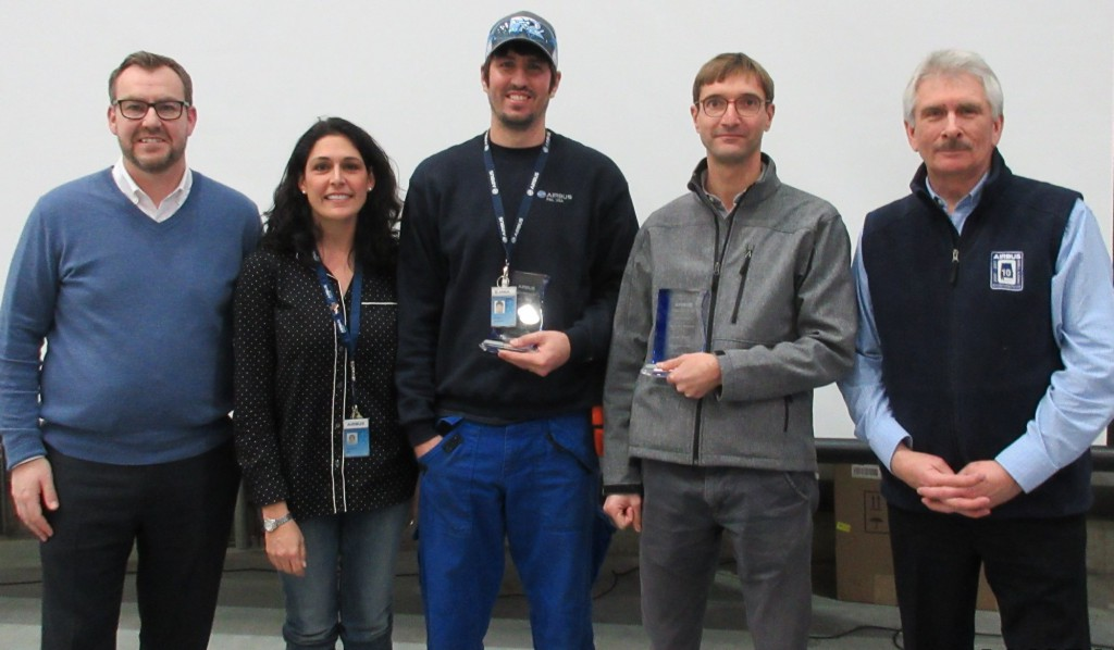 Daryl Taylor (far left), Stephanie Burt (2nd from left) and Barry Eccleston (far right) presented two Peer Awards earlier this month to Michael Prestwood (center) and Vincent Seurot.