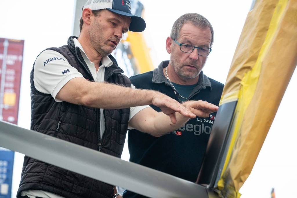 Yves Le-Biannic (left) shows Laurent Blattner (right) how wing technology is integrated into the boat.